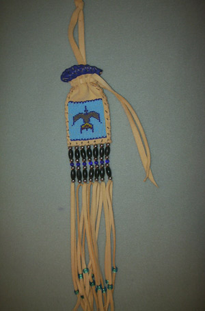 Small beaded tabacco bag  Crane desgin